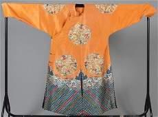 A fine apricot silk embroidered semi-formal robe, circa