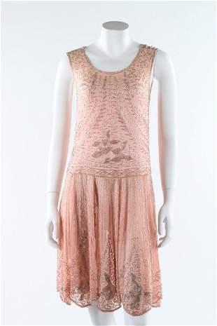 A beaded pink muslin flapper dress, circa 1928. adorned