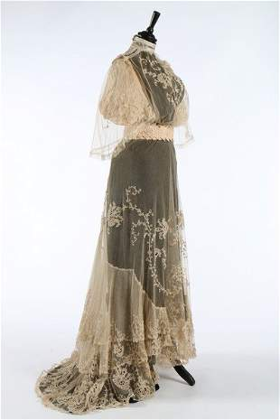 An embroidered and appliqued lace bridal gown, circa