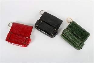 Three Yves Saint Laurent crocodile and snakeskin