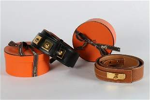 Two Hermes belts, one of tan leather with a