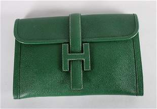 An Hermes green leather pochette, stamped under flap,