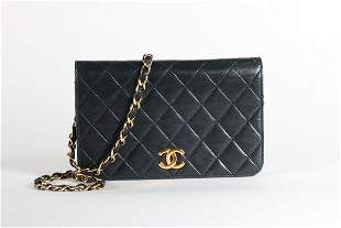A Chanel quilted navy leather bag, stamped to interior,