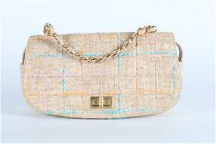 A matching Chanel tweed handbag, 2001, stamped to