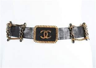 A Chanel leather and chain belt, stamped Chanel, buckle