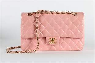 A Chanel pink leather double flap bag, stamped to
