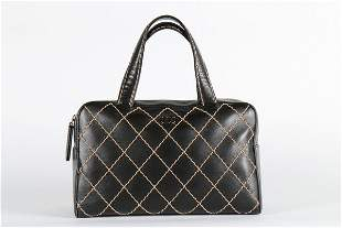 A Chanel black leather tote bag, label to lining, with
