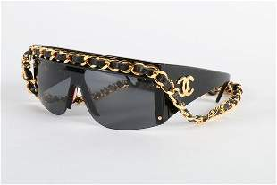 A pair of Chanel sunglasses, 1991, the upper frames