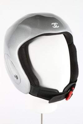 A Chanel ski helmet, with silver finish, CC logo to