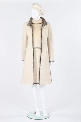 A Chanel cream tweed ensemble with black blanket stitch