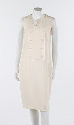 A group of ivory Chanel boutique clothing, comprising: