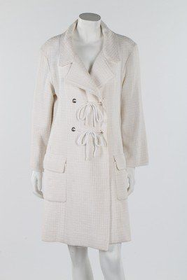A Chanel cream and white tweed coat, 2007, boutique