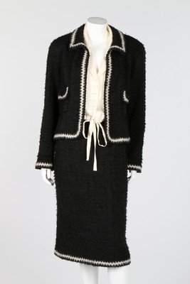 A Chanel black tufted tweed suit, circa 2000, boutique