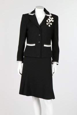 A Chanel black wool suit with white satin ribbon