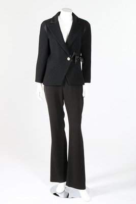 A Chanel black wool jacket with satin bow to waist,