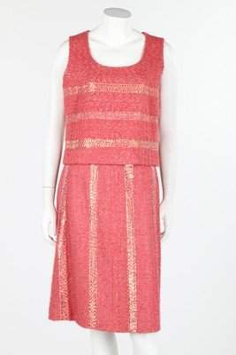 A group of mainly pink or summery Chanel garments,