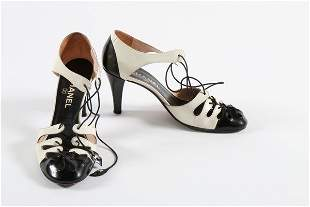 Three pairs of Chanel black and white shoes, comprising