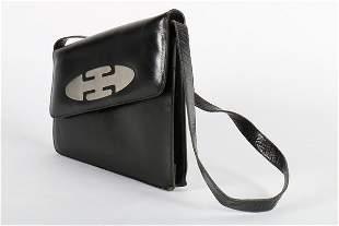 A Pierre Cardin black leather shoulder bag, 1960s,