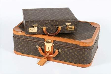 A Louis Vuitton monogrammed hard-sided suitcase, with