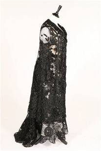 A black tapelace and tulle coat, circa 1910, together