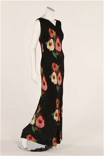 A printed black lame evening gown, circa 1930, bust