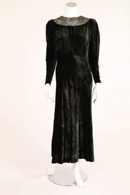 A black velvet evening dress,1930s, neckline beaded