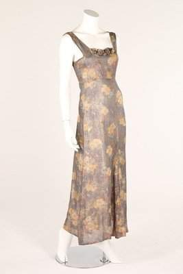 A blue floral lame evening gown, 1930s, together with