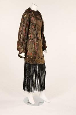 A black and gold lame dress, late 1920s, with fringing