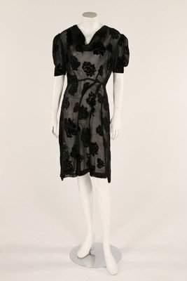 A 1930s black devorebias cut dress, bust 92in,36cm;