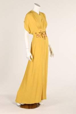 Two summer evening gowns, 1940s, one of yellow silk