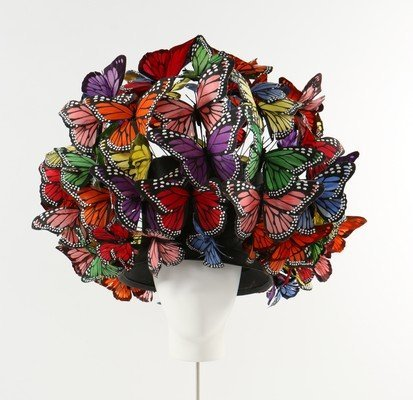 A Philip Treacy painted feather 'butterfly' hat, 2003,