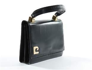 A Pierre Cardin navy leather handbag, probably late