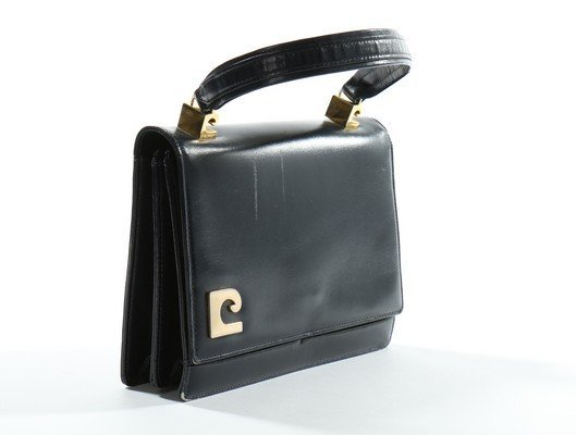 A Pierre Cardin navy leather handbag, probably late