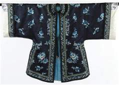 A woman's embroidered navy satin informal robe,