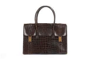 An Hermès brown crocodile 'Drag' bag and wallet, late