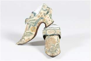 A fine pair of embroidered leather lady's shoes, circa