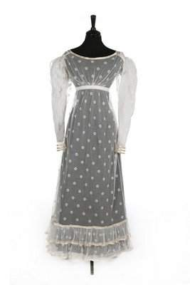 A sprigged and embroidered tulle dress, circa 1820-25,