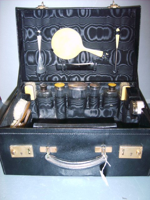 5: A dressing set, French 1920s, the black leather case