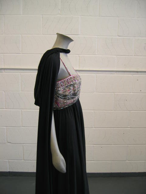 110: A Pucci evening gown and Loris Azzaro cape, late 1 - 2