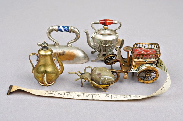 204: Four novelty tape-measures, French circa 1900-1920