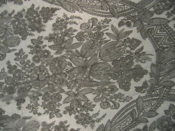 216: Two black Chantilly lace shawls, circa 1860, one t