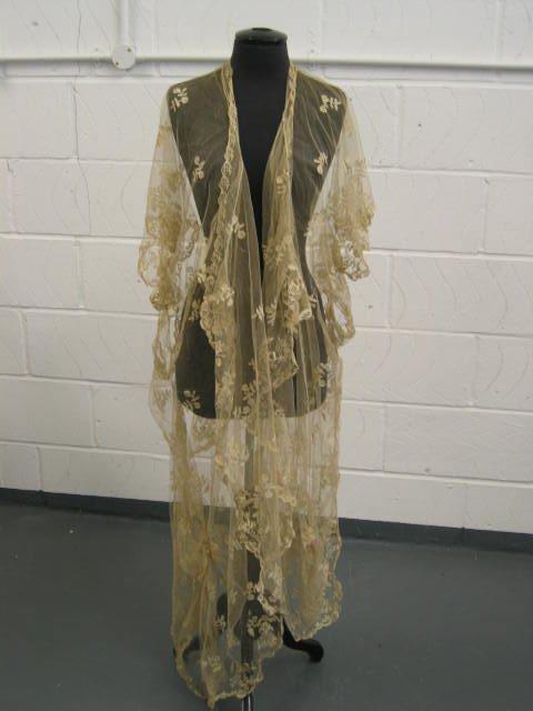 217: A Honiton appliqué tri-angular shawl or veil, mid