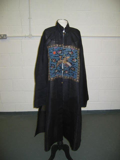 230: A blue gauze summer surcoat with integral embroide