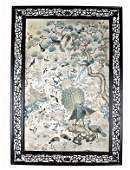 232: An embroidered Cantonese panel in original carved