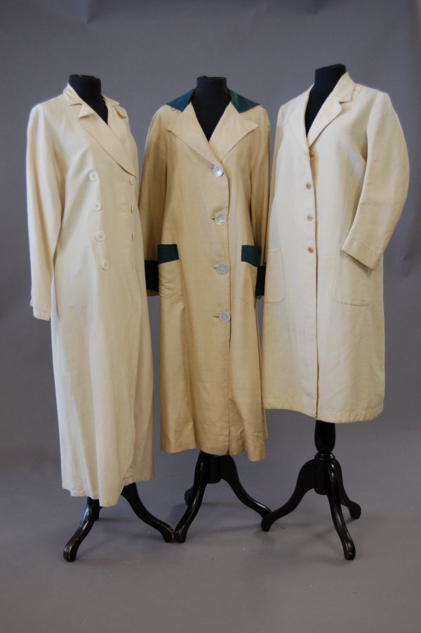 1128: A group of driving/linen garments, 1900-1930s, si