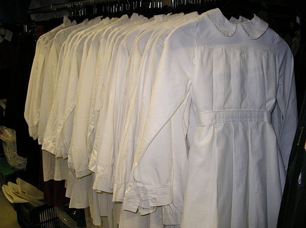 2003: A group of white cotton convent dresses, approx.