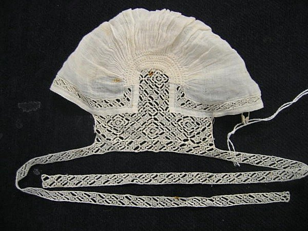 4: A fine and rare baby's coif with delicate cutwork ba