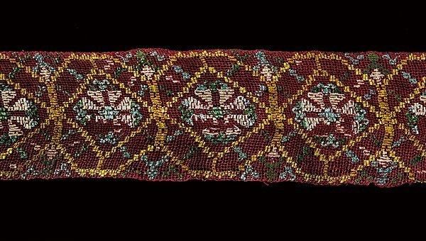 11: A rare coloured silk insertion of Buratto lace, Ita
