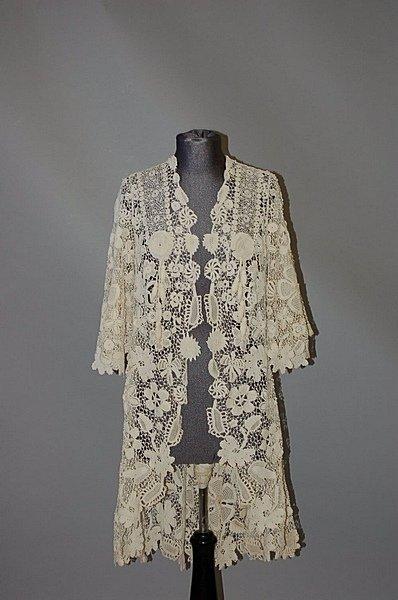 188: An Irish crochet coat, circa 1912, hip-length, wit