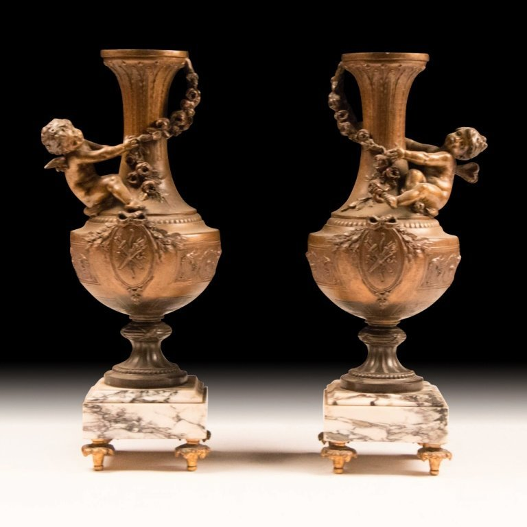 Pair of 19th Century Vases with Cherubs